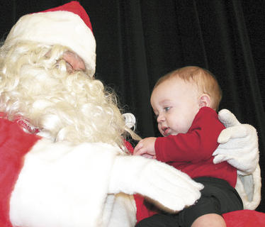 Dijae Robinson-Krawiec, the six month old son of Michelle Robinson and Domick Krawiec of Williamstown, wasn't afraid of Santa. He gave his beard a little tug.