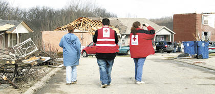 Members of Grant County's Chapter of the American Red Cross survey the damage on March 3. A temporary shelter was set up at Grant County High School for families displaced by the tornado.