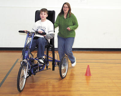 Rachel Simpson, gives her son, Mason Simpson, a little help guiding his bicycle during the Dry Ridge Elementary Bike Rodeo.
