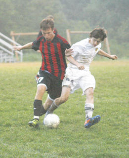 Sebastian Tackett fights with the Pendleton County player for the ball. The Braves lost the game 8-0 Sept. 8.