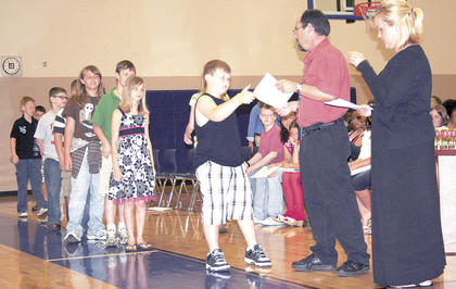 Colton Dalton receives his fifth grade diploma from Sherman Elementary Principal David Fordyce.