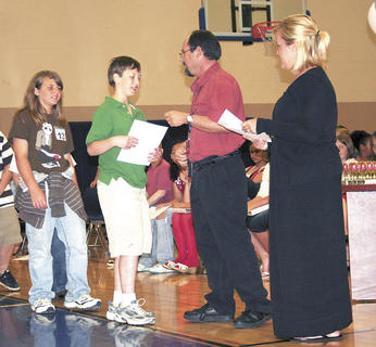 Aaron Flick received his fifth grade diploma from Sherman Elementary Principal David Fordyce and Mrs. Ashlee Schmitz.