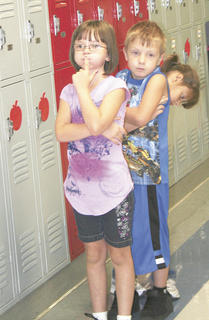 Dakota Edington makes sure that Logan Lonaker stays quiet in the hall at Dry Ridge Elementary.