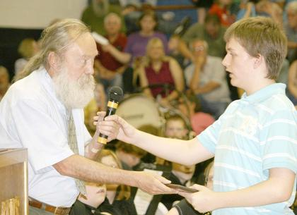 Brady Hermens gets an award from Nick Catey at the GCMS promotion ceremony.