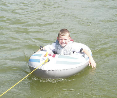 Spencer Breeden, enjoyed being pulled around the lake.