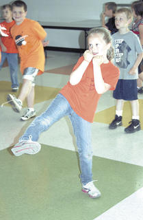 Chloe Roundtree shows off her high kick while she learns taebo at WES's track and field day.