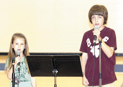 Braydon and Carlee Dungan sing for the audience at the WES elementary show.