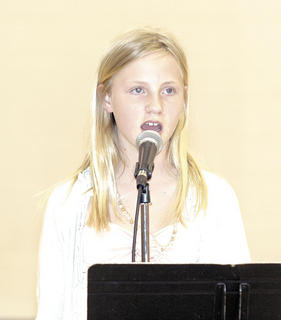 Shelby Gutman displays her talent and sings at the WES talent show.