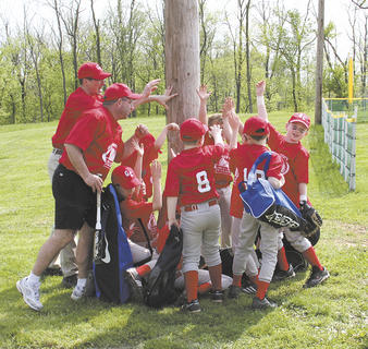 The Rangers rally after winning the tournament.