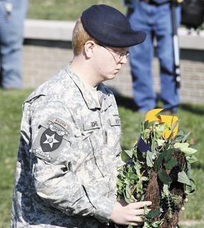 Bronson Van-Scoy of GCHS ROTC lays a wreath during the Veterans Day ceremony.