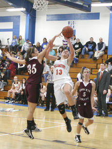 "<div class=""source"">Matt Birkholtz</div><div class=""image-desc"">Lady Demons sophomore forward Alex Prokopchak gets fouled on the shot.</div><div class=""buy-pic""><a href=""/photo_select/8875"">Buy this photo</a></div>"