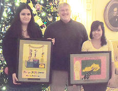 "<div class=""source""></div><div class=""image-desc"">Appy Webster, left, won first place and Anna Ramirez placed third in the 15-17 age group during the KTC 2010 Adopt-a-Highway Poster Contest. The students are pictured with WHS art teacher Mike Walters.</div><div class=""buy-pic""></div>"