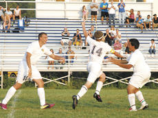"""<div class=""""source"""">Matt Birkholtz</div><div class=""""image-desc"""">Braves senior Brian Chapman (14) points to former Brave Lincoln Howe after scoring a goal against Boone County Aug. 18.</div><div class=""""buy-pic""""><a href=""""/photo_select/11807"""">Buy this photo</a></div>"""