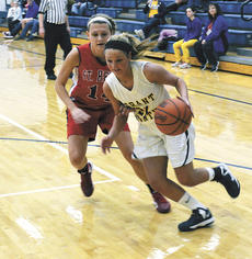 """<div class=""""source""""></div><div class=""""image-desc"""">Raven Wilson zooms past a St. Henry defender. Despite the Lady Braves efforts, they fell to the Lady Crusaders 59 - 46 on Jan. 24.  </div><div class=""""buy-pic""""><a href=""""/photo_select/16814"""">Buy this photo</a></div>"""