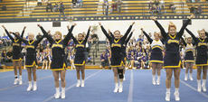 "<div class=""source"">Matt Birkholtz</div><div class=""image-desc"">The GCHS cheerleading squad performs a routine at the end of the Jingle Bell Classic. The cheerleading squad does not perform in their home event, but still put on an exhibition for the crowd. The GCMS eighth grade won the medium one grade trophy and the sixth grade squad competed as well at the competition.</div><div class=""buy-pic""></div>"