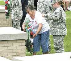 """<div class=""""source""""></div><div class=""""image-desc"""">Geneva Seale of Dry Ridge places a wreath beneath the Navy flag during the Memorial Day service.</div><div class=""""buy-pic""""><a href=""""/photo_select/3120"""">Buy this photo</a></div>"""