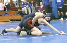 """<div class=""""source"""">Matt Birkholtz</div><div class=""""image-desc"""">Freshman Austin Gripshover tries to lock in Ryle's Dallas Pruett in the 103lb. class. Grisphover placed sixth in his weight class.</div><div class=""""buy-pic""""><a href=""""/photo_select/9205"""">Buy this photo</a></div>"""
