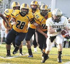 """<div class=""""source""""></div><div class=""""image-desc"""">Hunter Lawson, Colton Smith and Triston Wallace advance on a Middlesboro Yellow Jacket player. </div><div class=""""buy-pic""""><a href=""""/photo_select/18702"""">Buy this photo</a></div>"""