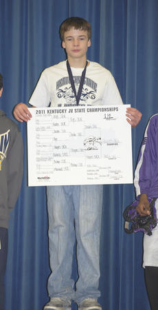 """<div class=""""source"""">Photo Submitted</div><div class=""""image-desc"""">Tommy Haynes holds up the bracket during the award ceremony. </div><div class=""""buy-pic""""></div>"""
