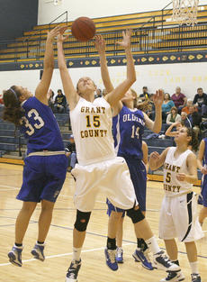 """<div class=""""source"""">Matt Birkholtz</div><div class=""""image-desc"""">Lady Braves sophomore Billie Hearn goes for an offensive rebound against Oldham County Jan. 15.</div><div class=""""buy-pic""""><a href=""""/photo_select/8882"""">Buy this photo</a></div>"""