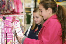 """<div class=""""source"""">Linda Lawrence</div><div class=""""image-desc"""">Katlynn Nickell and Hayley Leach look at a Barbie for a 6-year-old girl.</div><div class=""""buy-pic""""><a href=""""/photo_select/8550"""">Buy this photo</a></div>"""