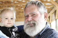 "<div class=""source"">Linda Lawrence</div><div class=""image-desc"">Dwight McComas holds his grandson Linkon.</div><div class=""buy-pic""></div>"