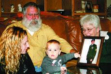 "<div class=""source"">Linda Lawrence </div><div class=""image-desc"">Linkon McComas, age 1, is learning about is father, Army Staff Sgt. Dirk McComas, from his mother Allie, and grandparents, Dwight and Marlene McComas.</div><div class=""buy-pic""></div>"