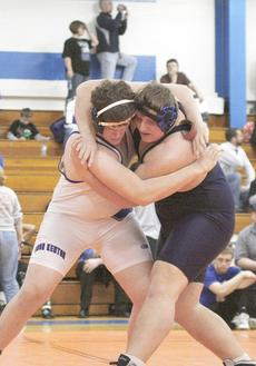 """<div class=""""source"""">Matt Birkholtz</div><div class=""""image-desc"""">Sophomore Cody Miskell tries to take down Simon Kenton wrestler Colin Patrick in the heavyweight division. Miskell placed sixth overall in the weight class, one place shy of being an alternate at the state meet Feb. 16-19 at Frankfort Convention Center.</div><div class=""""buy-pic""""><a href=""""/photo_select/9206"""">Buy this photo</a></div>"""