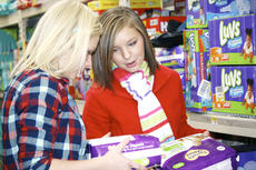 """<div class=""""source"""">Linda Lawrence</div><div class=""""image-desc"""">Caylee Ruber and Bethany Lawrence try to figure out the correct size diapers for an 18-month old.</div><div class=""""buy-pic""""><a href=""""/photo_select/8546"""">Buy this photo</a></div>"""