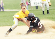 "<div class=""source"">Ryan Naus</div><div class=""image-desc"">Lady Braves infielder Erica Stith lays the tag on Williamstown runner Emma Harris during a game last season. Grant County would eventually place second at regionals, compiling a record of 25-13. Lady Braves coach Ott Reed was named 8th Region Coach of the Year and pitcher Kaitlynn Roy was named to the All-Region team.</div><div class=""buy-pic""></div>"
