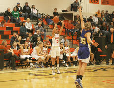 "<div class=""source"">Matt Birkholtz</div><div class=""image-desc"">Williamstown senior point guard Chelsea West shoots a three-point shot over a Trimble County defender during a 48-46 come from behind win for the Lady Demons Dec. 10 at home. </div><div class=""buy-pic""></div>"