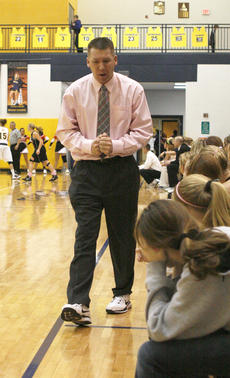 "<div class=""source"">Matt Birkholtz</div><div class=""image-desc"">Lady Demons coach Mark Wilhoit dons sneakers for the first of three Coaches vs. Cancer games in Grant County. The next game involves his Lady Demons facing Walton-Verona at 7:30 p.m. Jan. 28.</div><div class=""buy-pic""><a href=""/photo_select/8910"">Buy this photo</a></div>"