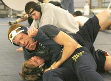"<div class=""source"">Matt Birkholtz</div><div class=""image-desc"">Logan Willoughby and Isaiah Leonard practice some wrestling moves in the GCHS cafeteria Feb. 7.</div><div class=""buy-pic""><a href=""/photo_select/9176"">Buy this photo</a></div>"