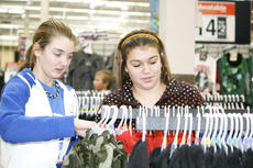 """<div class=""""source"""">Linda Lawrence</div><div class=""""image-desc"""">Macy Wright and Brittany Hudson, eighth graders at GCMS, shop for something warm for a little boy.</div><div class=""""buy-pic""""><a href=""""/photo_select/8549"""">Buy this photo</a></div>"""