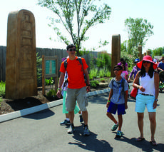 """<div class=""""source"""">Amanda Kelly</div><div class=""""image-desc"""">The Ai family from Hickory, North Carolina stroll through the Monument Park towards the Ark entrance. </div><div class=""""buy-pic""""><a href=""""/photo_select/29587"""">Buy this photo</a></div>"""
