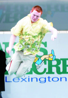 """<div class=""""source"""">Bryan Marshall, staff writer</div><div class=""""image-desc"""">Richard Moore, a senior at Williamstown High School, gets some air while participating in the Polar Bear Plunge.</div><div class=""""buy-pic""""><a href=""""/photo_select/8203"""">Buy this photo</a></div>"""