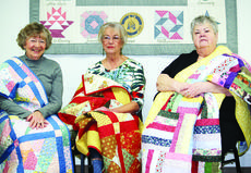 """<div class=""""source"""">unknown</div><div class=""""image-desc"""">Maxine Brown, Sandra Harney and Rosemary Breeden received quilts made by Loving Stitchers Club after the loss of their husbands. </div><div class=""""buy-pic""""><a href=""""/photo_select/25604"""">Buy this photo</a></div>"""