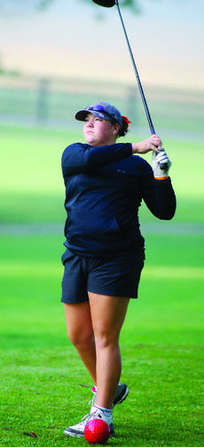 """<div class=""""source""""></div><div class=""""image-desc"""">Williamstown's Madison Hudson watches her ball after a drive. </div><div class=""""buy-pic""""><a href=""""/photo_select/29701"""">Buy this photo</a></div>"""