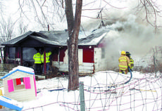 "<div class=""source"">Jamie Baker-Nantz</div><div class=""image-desc"">Williamstown firefighters battled a fire and snow-covered roads on Dec. 17 in a fire on Swanee Shores that destroyed the home of David Campbell and his family and later battled a kitchen fire on Sunset Drive.</div><div class=""buy-pic""></div>"