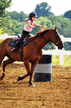 """<div class=""""source""""></div><div class=""""image-desc"""">Makenah McKenney gallops around a barrel on her horse. Photo by Camille McClanahan</div><div class=""""buy-pic""""><a href=""""/photo_select/18506"""">Buy this photo</a></div>"""