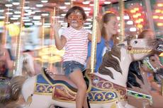 """<div class=""""source""""></div><div class=""""image-desc"""">Hailey Hamilton waves while riding the carousel. Photos by Bryan Marshall</div><div class=""""buy-pic""""><a href=""""/photo_select/18564"""">Buy this photo</a></div>"""