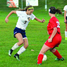 """<div class=""""source"""">Jerry Morris</div><div class=""""image-desc"""">Amber Faehr fights for possession of the ball. The Lady Braves tied with the Pendleton County Wildcats on Oct. 2. </div><div class=""""buy-pic""""></div>"""