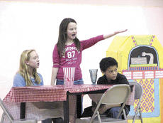 "<div class=""source""></div><div class=""image-desc"">WES fifth graders Darcy Adkins and Keegan Bailey listen as Morgan Thompson delivers lines during rehearsal of ""Jingle Bell Jukebox.""</div><div class=""buy-pic""><a href=""/photo_select/9065"">Buy this photo</a></div>"