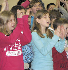 "<div class=""source""></div><div class=""image-desc"">Fifth graders Jessica Sprinkles and Madison Helton clap as they sing a tune from the play. </div><div class=""buy-pic""><a href=""/photo_select/9066"">Buy this photo</a></div>"
