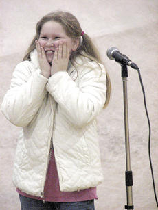"<div class=""source""></div><div class=""image-desc"">Fifth grader Emily Wallace reacts after singing lines from ""The Grinch"" during rehearsals. </div><div class=""buy-pic""><a href=""/photo_select/9067"">Buy this photo</a></div>"