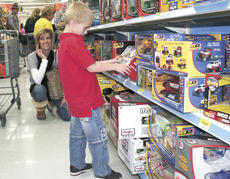 "<div class=""source"">Jamie Baker-Nantz</div><div class=""image-desc"">Rendell, a participant in the Shop With A Trooper program, carefully makes a toy selection on Dec. 11 at Wal-Mart in Dry Ridge.</div><div class=""buy-pic""></div>"