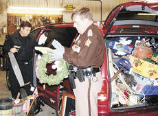 "<div class=""source""></div><div class=""image-desc"">Grant County Sheriff Chuck Dills, left, and Deputy Terry Osborne sort through items allegedly stolen from local grave sites.</div><div class=""buy-pic""><a href=""/photo_select/3586"">Buy this photo</a></div>"
