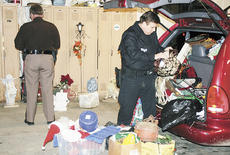 "<div class=""source""></div><div class=""image-desc"">Sheriff Chuck Dills and Deputy Terry Osborne sort through a van and storage building filled with items they believe Kimberly Goodrich took from local cemeteries. Goodrich has been arrest on charges of receiving stolen property.</div><div class=""buy-pic""><a href=""/photo_select/3587"">Buy this photo</a></div>"