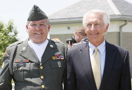 Grant County Honor Guard member Terry Conrad stands with Gov. Steve Beshear. Conrad is an Army Veteran of the Vietnam War.