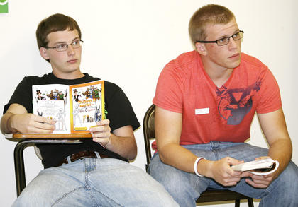 Corey Cartwright and John Evans IV listen to a story about Eleazar.